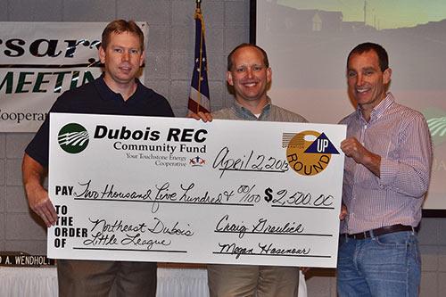 Northeast Dubois Little League: Jon Merkel and Brennan Schepers accept the award from Operation Round Up Trustee Pat Seger.