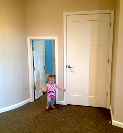 Piper demonstrating the kid-sized door added for children to walk back into procedure area. Just one of many special touches at the new office. Other kid friendly amenities are beanbag chairs and plenty of smiles. Photo from the Seng Pediatric Dentistry Facebook page