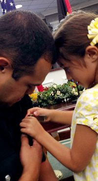 Martin Loya's daughter Jazlyn pinned his badge on during the swearing-in ceremony held Monday for the Jasper Police Department.