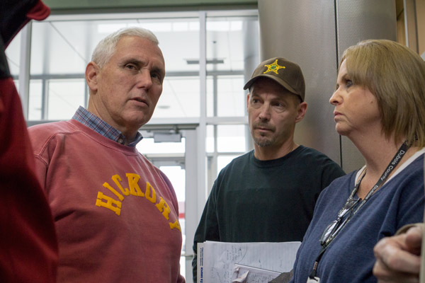 Gov. Mike Pence met with county and state officials at the Center for Technology, Innovation and Manufacturing at VUJC Saturday. In the photo from left: Gov. Pence, Dubois County Sheriff Donny Lamper and Dubois County Emergency Management Director Tammy Humbert.