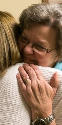 Irma (right) and Admissions Corridinator Mary Denu embrace at the retirement community. Hugs are common at Northwood.