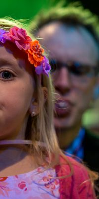 Sophia DeKemper, 6, blew a bubble for a bubble blowing contest during the Daddy Daughter Dance held at the Teen Outback Thursday. Her dad Brian is behind her.