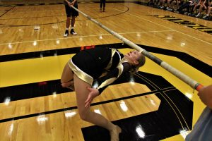 """""""How Low Can You Go."""" Emily earned an honorable mention for this photo of Hannah Welp during a pep rally for basketball sectionals held in February. Emily said she was a bit nervous about taking the photo in front of the school but moved out into the gymnasium floor at the urging of Mr. Elrod."""