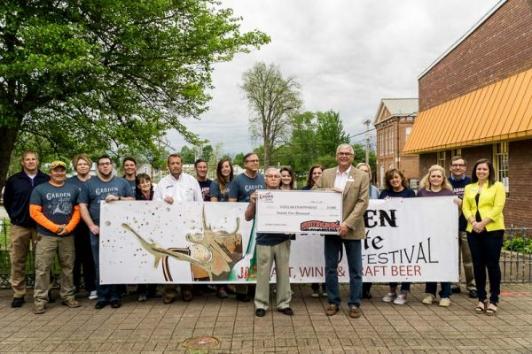 As representative of the Stellar Committee Huntingburg Mayor Denny Spinner accepted the $25,000 check from Huntingburg Chamber Board President Al Mihaljovitz Friday morning.  The money is specifically earmarked to the creation of the Market Street Park.