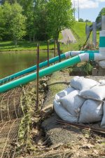 The sandbags indicated the most recent breach of the dam that caused the road to be closed.