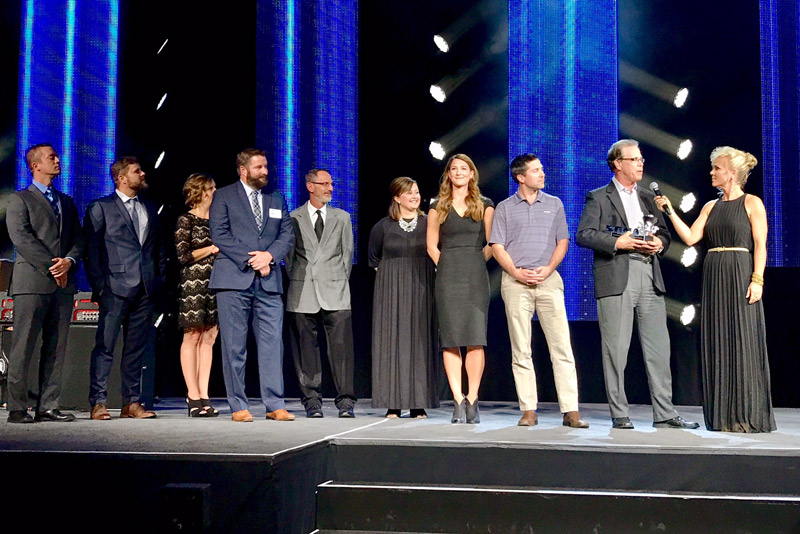 Mike Braun, president and CEO of Meyer Distributing, accepting the 2017 SEMA Warehouse Distributor of the Year award last night in Las Vegas from celebrity Jessi Combs. From right: Braun was joined by Jeff Braun, Kristen Braun, Kristy Neukam, Wayne Abel, Nick Gramelspacher, Natalie Tempel, Shawn O'Connor and Cody Ziegler.