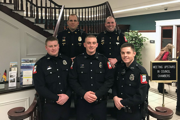 Front: Officers Michael Conrad, Josh Greener and Caleb Lindeman were sworn in during Wednesday's common council meeting.